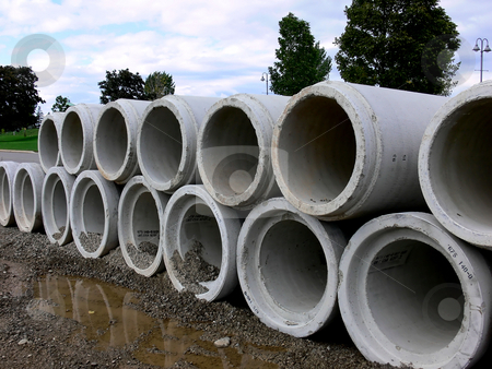 Concrete pipe    stock photo, A stack of concrete pipes on a road construction site. by Horst Petzold
