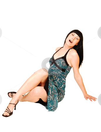 Sitting woman in blue green dress. stock photo, A young pretty woman sitting on the floor and having fun for white background and shooing her great figure. by Horst Petzold