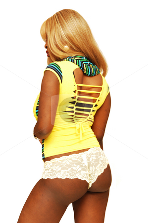 Young Jamaican girl in panties. stock photo, An young blond Jamaican girl in beige panties, high heels and yellow top, standing for white background in a studio. by Horst Petzold
