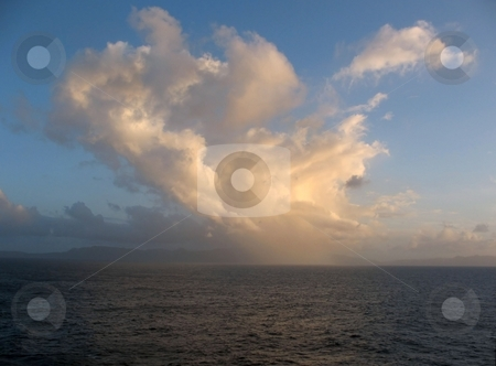 A  Beautiful Scene of Sea, Cloude and Sky stock photo, This image is showing Samana, Dominican Republic in the distant background, with a lovely cloud bank as the sun was setting by Ray Carpenter