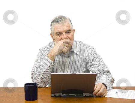 Senior thinking stock photo, Senior thinking with laptop on white background by John Teeter
