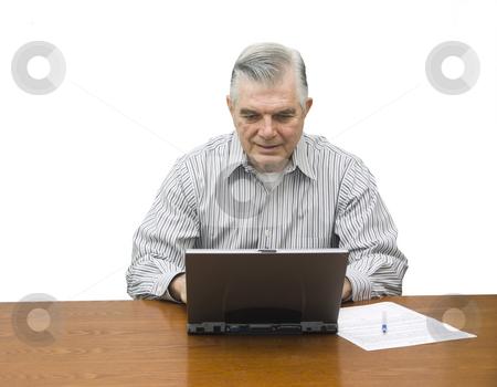 Senior working on laptop stock photo, Senior working on laptop with white background by John Teeter