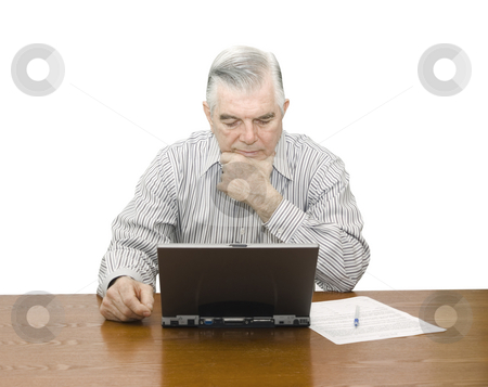 Senior concentrating on Laptop stock photo, Senior Concentrating on Laptop with white background by John Teeter
