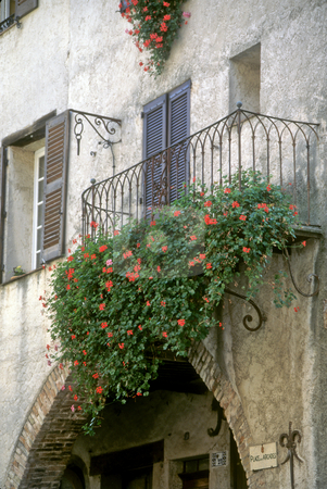 Cascade of flowers from a St Paul de Vence balcony stock photo, Flowered balcony, St Paul de Vence, Alpes-Maritime, France by GB Tittle