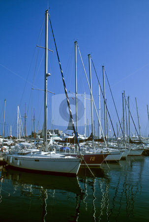 Marina at Antibes, Cote d'Azur stock photo, Sailboats lined up at the marina in Antibes, Cote d'Azur by GB Tittle