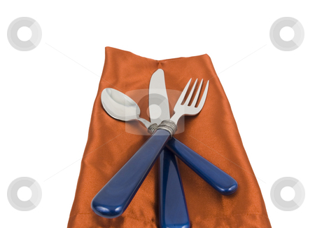 Silverware stock photo, Spoon, knife and fork on a nakpin on white background by John Teeter