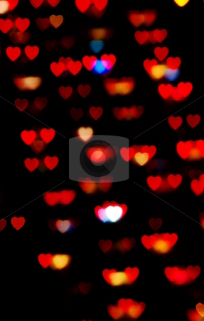 Heart-shaped lights stock photo, Night lights blurred into heart-shaped bokeh by Martin Darley