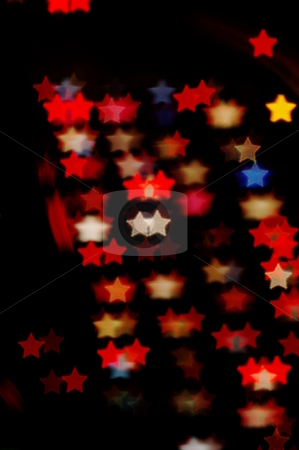 Star-shaped lights stock photo, Night lights blurred into star-shaped bokeh by Martin Darley