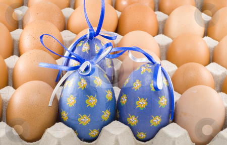 Blue Easter Eggs stock photo, Three blue easter eggs among a lot of common ones by Petr Koudelka
