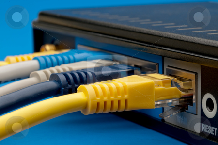 Network cables plugged into a router on red stock photo, Network cables plugged into a router on red by Vince Clements