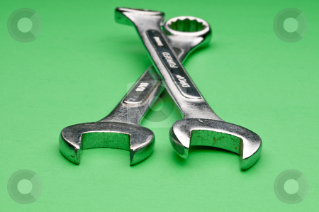 Horizontal image of a pair of old worn comnination wrenches on a stock photo, Horizontal image of a pair of old worn comnination wrenches on a green background by Vince Clements