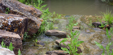 Stream stock photo, Stream flowing over rocks by Marburg
