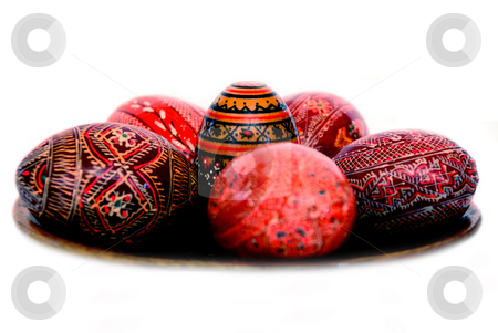 Easter eggs stock photo, Easter eggs on a wooden plate isolated on a white background by Alexey Rumyantsev