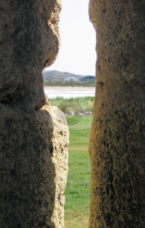 View of countryside through stone stock photo, View of countrysideas seen through a space in a stone wall by Jaime Pharr