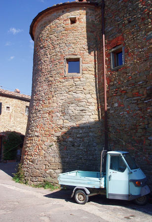Stone building in Tuscany with small truck    stock photo, Stone building in Tuscany with small truck by Jaime Pharr