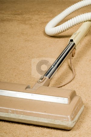 Vaccum Cleaner stock photo, An old vacuum cleaner on resting unused on the carpet by Richard Nelson