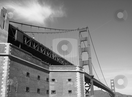 Golden Gate bridge  stock photo, Black and white image of Golden Gate bridge with building in the foreground by Jaime Pharr