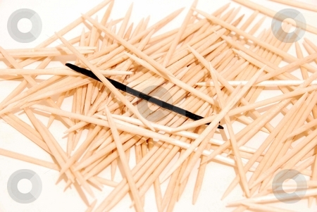 Tooth-picks stock photo, Tooth-picks with one black isolated on a white by Alexey Rumyantsev