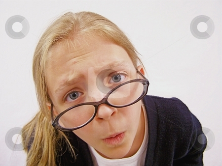 Girl with glasses being silly stock photo, Young girl with glasses being silly. by Gregory Dean