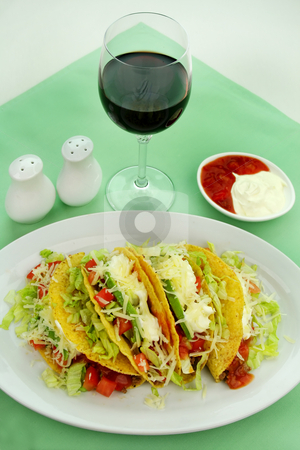 Beef Tacos stock photo, Delicious beef tacos with beef, lettuce, tomato salsa, avocado, grated cheese and sour cream. by Brett Mulcahy