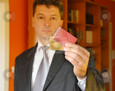 Businessman with credit cards stock photo, Mature businessman holding plastic credit cards in hand by Julija Sapic