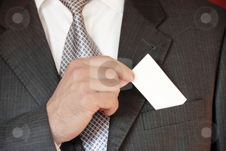 Businessman with business card stock photo, Businessman hand holding a business card over suit pocket by Julija Sapic