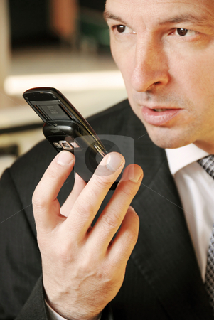 Businessman with mobile phone stock photo, Business man with mobile phone in hand by Julija Sapic