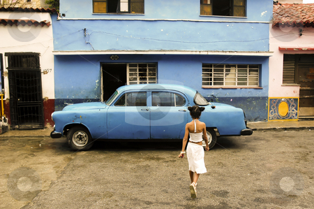 Young Girl Crossing Road stock photo, Cuba by Michael Cohen