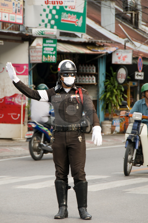 Traffic Policeman stock photo, Vientiane,  Laos - August 4: Policemen directing traffic wearing smog mask by Michael Cohen