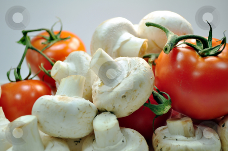 Tomatoes and mushrooms stock photo, Fresh vegetables: tomatoes and mushrooms by Fernando Barozza