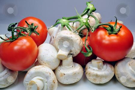 Tomatoes and mushrooms stock photo, Fresh vegetables: tomatoes and mushrooms by Fernando Barozza