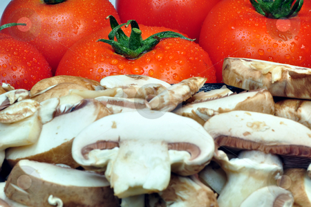 Tomatoes and mushrooms stock photo, Fresh vegetables: tomatoes and sliced mushrooms by Fernando Barozza