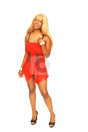 Young Jamaican girl in red. stock photo, An blond young Jamaican girl in an short red dress and high heels standing in an studio. by Horst Petzold