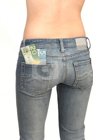 Young topples woman in jeans. stock photo, A young woman wearing only blue jeans from the back and shooing her nice round butt, with her savings in her back pocket for white background. by Horst Petzold