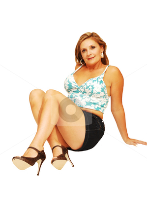 Young woman sitting  stock photo, An friendly blond girl in a blue and white top and short skirt sitting on the floor for white background. by Horst Petzold