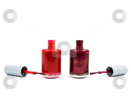 Finger nail polish stock photo, Finger nail polish bottles on a white background by John Teeter