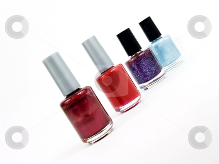 Finger nail polish stock photo, Finger nail polish bottles on a white background by John Teeter