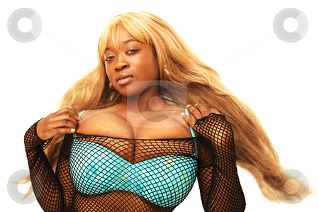 Young Jamaican girl stock photo, An young blond Jamaican girl in a bating suit and her big bust and long blond  hair is posing for the camera. by Horst Petzold