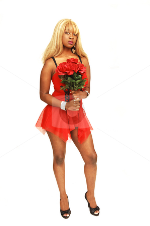 Young Jamaican girl in red. stock photo, An blond young Jamaican girl in an short red dress and high heels standing in an studio and holding red roses. by Horst Petzold