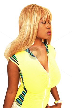 Young Jamaican girl  stock photo, An busty young Jamaican girl in a yellow top, long blond hair  standing in an studio for a nice portrait. by Horst Petzold