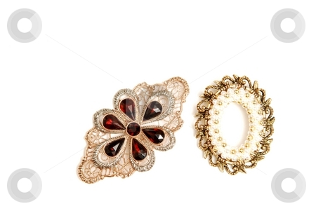 Two brooch. stock photo, Two brooch on white background with pearls and gems in gold. by Horst Petzold