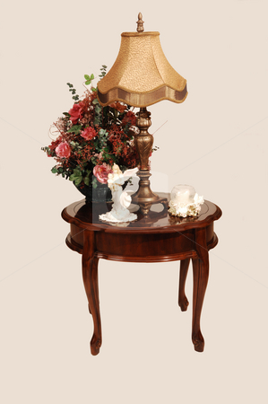 Antique side table. stock photo, A antique side table with an light fixture and nice silk flowers on. by Horst Petzold