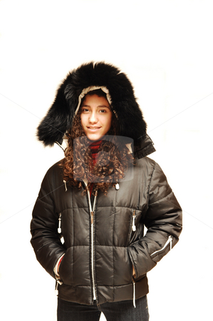 Young Lady in parka. stock photo, A young girl in jeans and red sweater with an winter coat on. by Horst Petzold