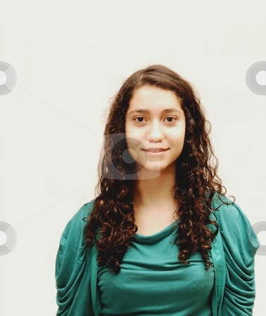 Young smiling girl. stock photo, A young girl in turquoise sweater for white background. by Horst Petzold