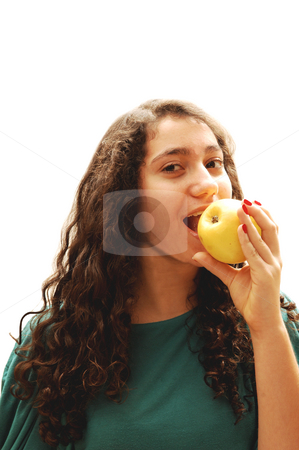 Young girl and apple. stock photo, A pretty lady whit an green apple for her diet standing for white background. by Horst Petzold