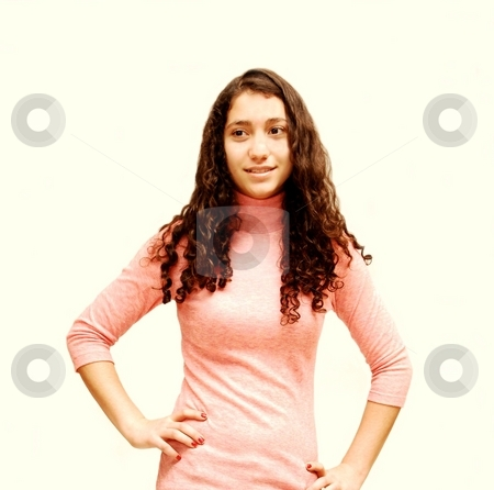 Young smiling girl. stock photo, A young girl in jeans and pink sweater for white background. by Horst Petzold