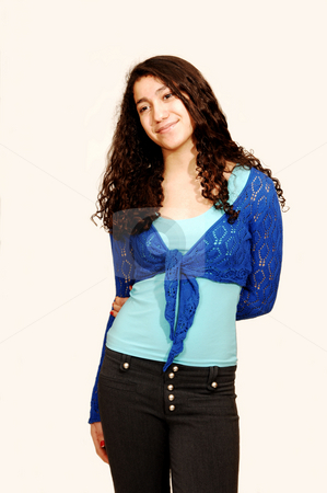 Young Lady. stock photo, A young girl in jeans and turquoise sweater. by Horst Petzold