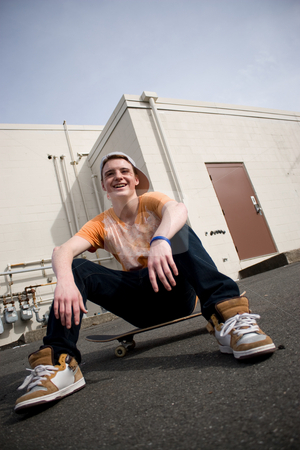 Skateboarder stock photo, A young skater resting on his board. by Todd Arena