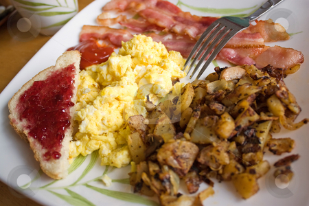 Big Delicious Breakfast stock photo, A complete breakfast with scrambled eggs bacon potatoes and toast. by Todd Arena
