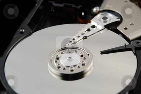 Hard drive interior stock photo, Stock pictures of the interior of a compute hard drive by Albert Lozano